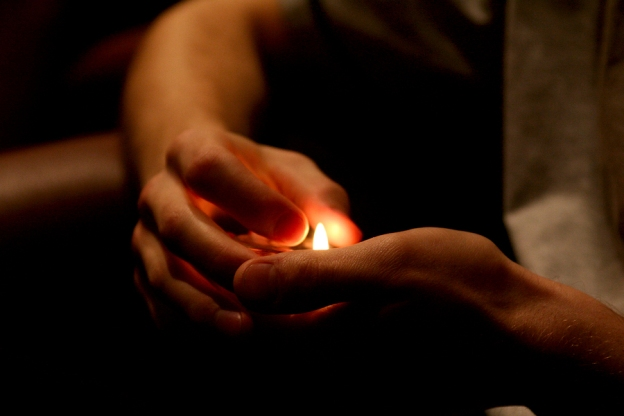 A Dot of Magic in His Hands Looks Like a Candle Flame