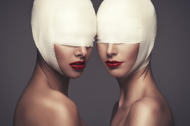 Take off your blindfold and see the cover for Dreadful Poetry.
